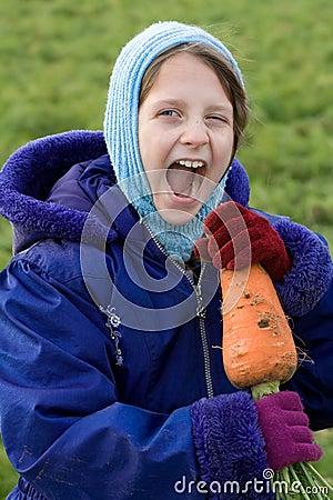 Child eating vegetable.