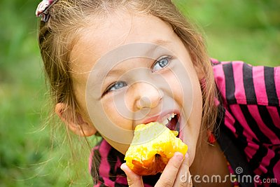 Child eats a peach