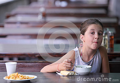 Child eats in a restaurant