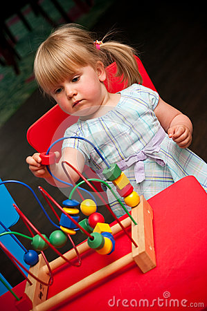 Child with educational toy