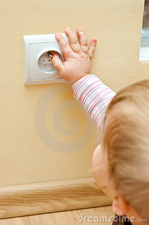 Child at electric socket