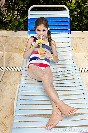 Child Enjoying A Tropical Drink At An Outdoor Pool Stock Photo Image 49240312