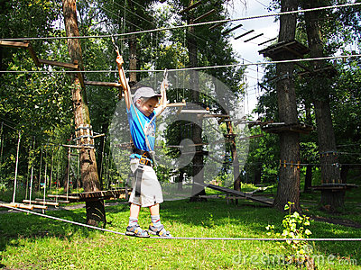 Child equipped climbing in rope park