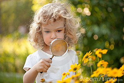 Child explorer flowers in garden
