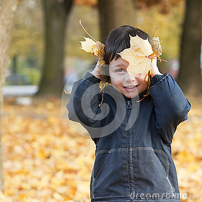 Child in fall park