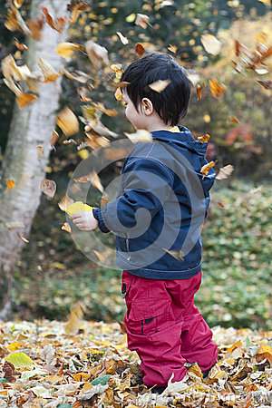 Child and falling leaves