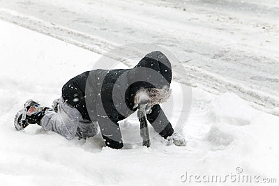 Child falls during snow storm in New York Editorial Stock Photo