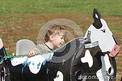 Child on a farm ride hayride