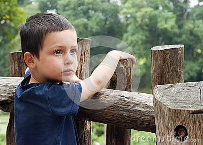 Child by fence