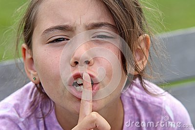 Child with finger to mouth.