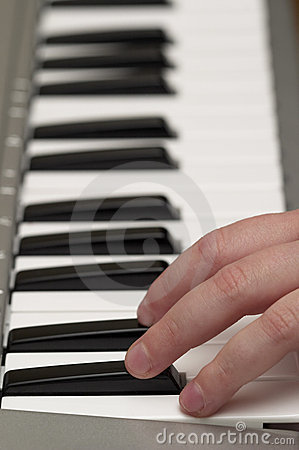 Child fingers on piano