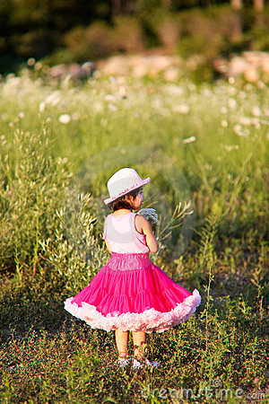 Child in a flower field