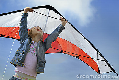 Child flying with a kite