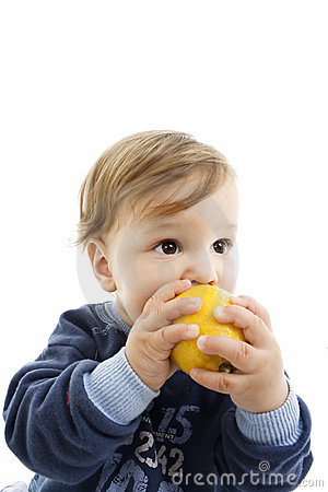 Child and fresh lemon