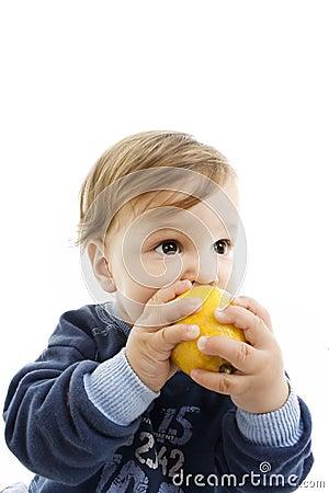 Child and fresh lemon