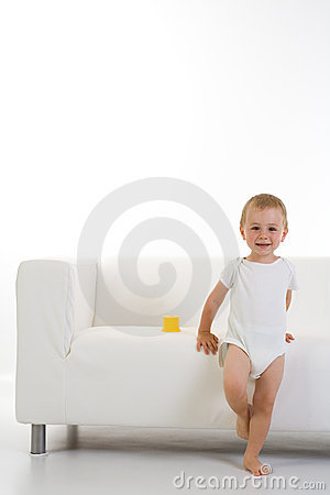 Child in front of couch/sofa