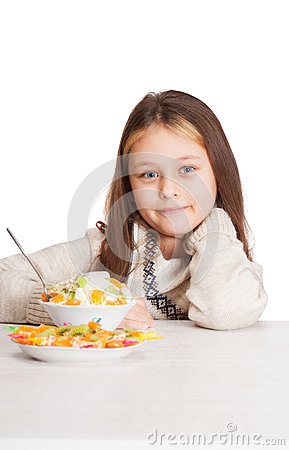 Child with a fruity dessert