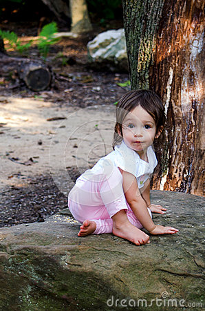 Child and garden rock