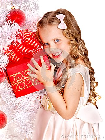 Child with gift box near white Christmas tree.