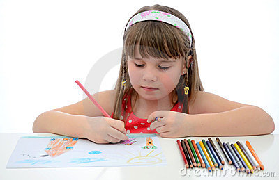 Child girl with colored crayons