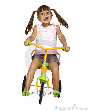 Child girl drive bicycle