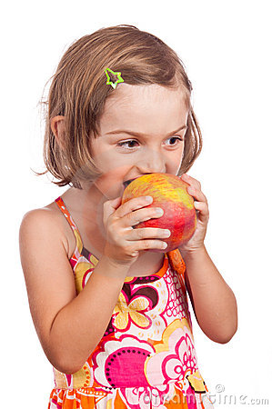 Child girl eating apple