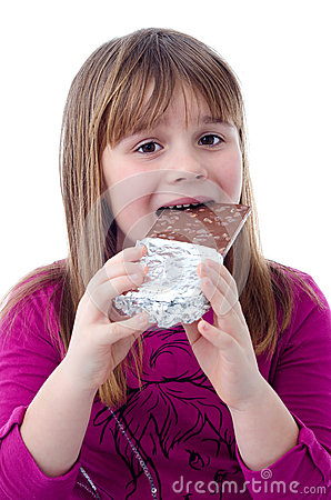 Child girl eating chocolate