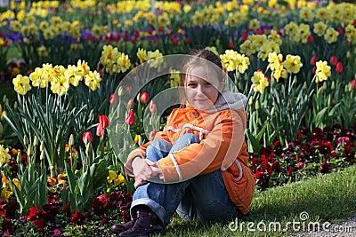 Child girl on a grass
