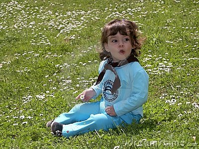 Child girl on the grass