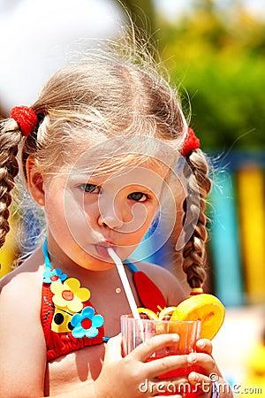 Free Child Girl In  Red Bikini Drink Orange Juice. Royalty Free Stock Image - 13117196