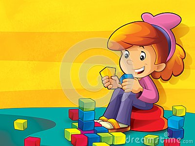 Child - girl in the kindergarten playing blocks
