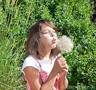 Child (girl) making a big wish!