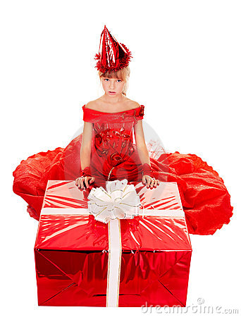Child girl in party hat and red gift box.