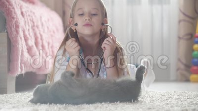 Child Girl Playing Doctor with Cat at Home. Girl Playing Veterinarian with Home Pet. Stock Footage - Video of medicine, patient: 135226850