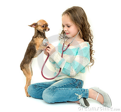 Free Child Girl Playing Veterinarian With Her Little Dog Royalty Free Stock Photos - 75792858