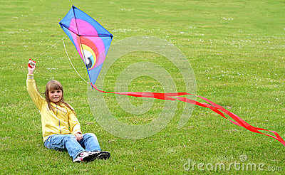 Child girl plays with kite