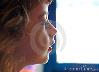 Child girl profile portrait in white window