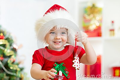 Child girl in santa hat holding christmas biscuits stock photo image