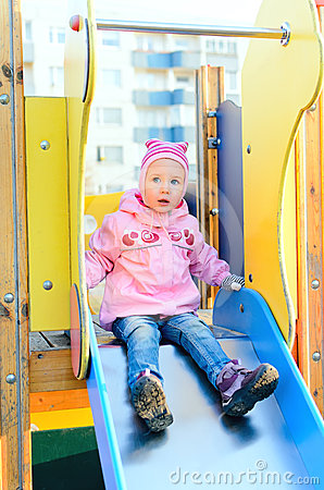 Child girl sitting on slide