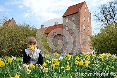 Child girl in spring park