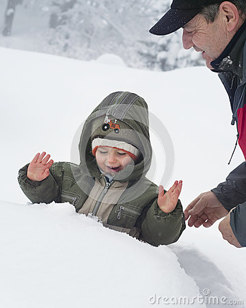 Child and grandfather in snow