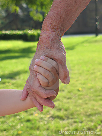 Child and grandmother holding hands
