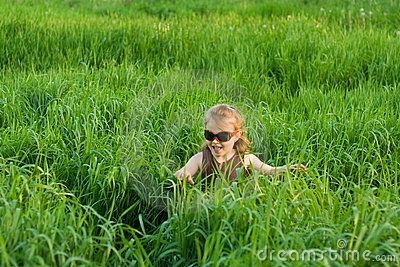 The child in a grass