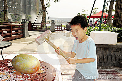 A child hammer a golden egg