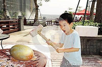 A child hammer a golden egg