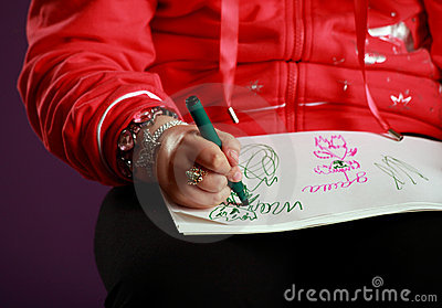 Child hand drawing pictures