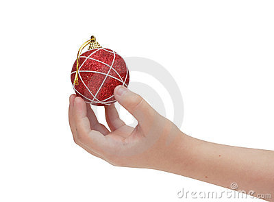 Child hand holding red christmas ball