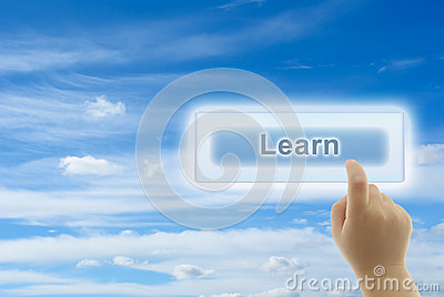 Child hand touching LEARN button