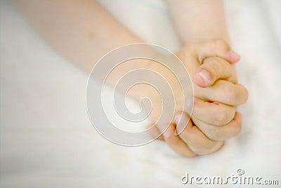 Child hands in prayer