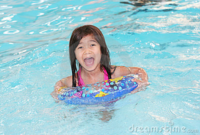 Child happily swimming